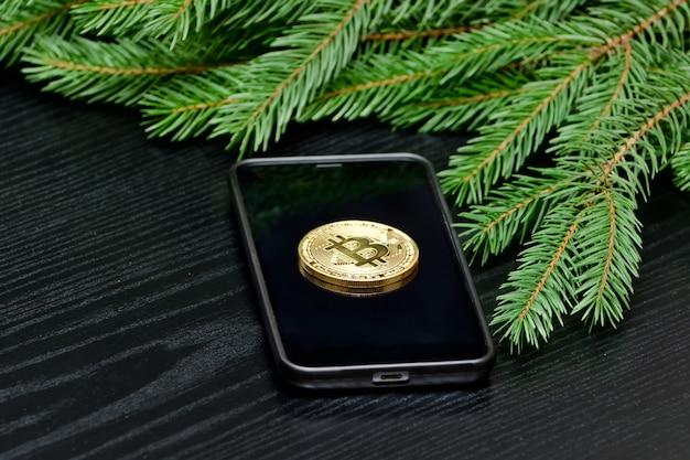 Moneta kryptowaluty bitcoin w telefonie