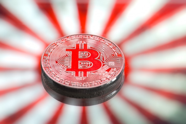 Monety bitcoin, na japonii i japońskiej fladze, koncepcja wirtualnych pieniędzy, zbliżenie. obraz koncepcyjny.