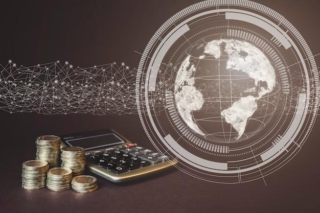 Monety stack i kalkulator oraz wirtualny gologram sieci światowej. koncepcja świata biznesu