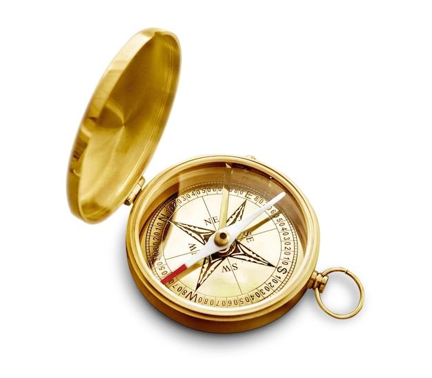 Mosiężny antyczny kompas na tle