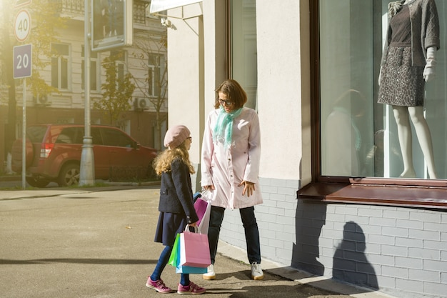 Mother and daughter - enjoying shopping trip together