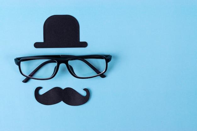 Movember tło świadomości wąsów w okularach.
