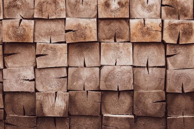 Mozaika kwadratowych drewnianych prętów.