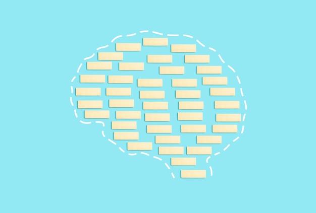 Mózg z bloków na czystym niebieskim tle świadomość myślenie demencja alzheimer zdrowie mózgu c...