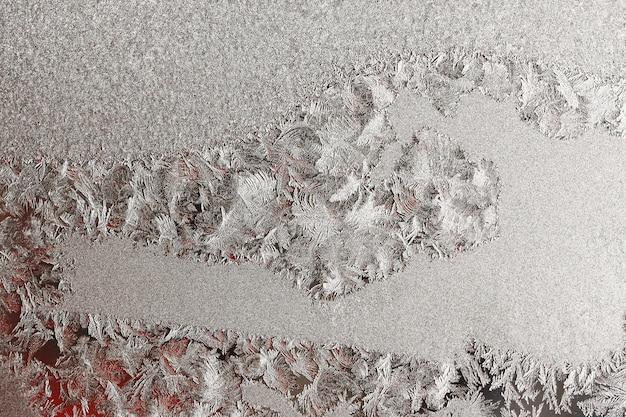 Mrożone zima streszczenie tło z wzorem na szybie okna
