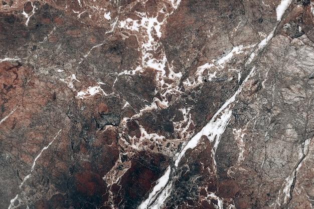 Mur bordowy marmurowy kamień tekstura.