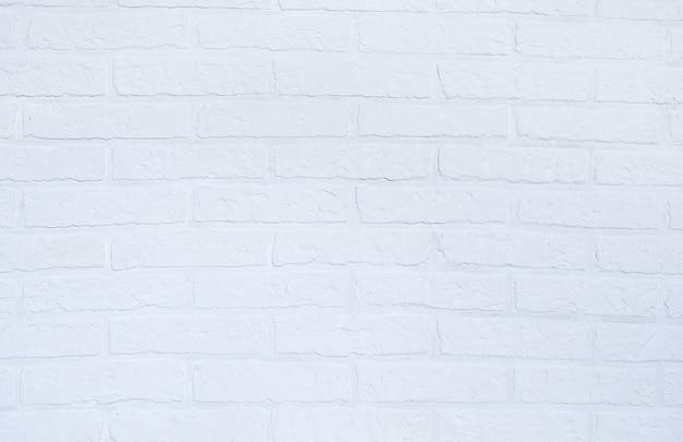 Mur z cegły białej szpachlówki. styl loft. ściana botonu