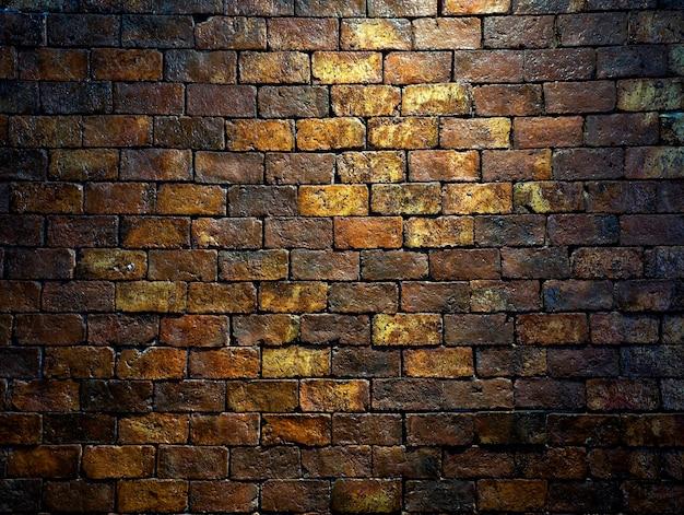 Mur z cegły, ciemne tło. stary grunge i antyczne żółty, pomarańczowy i brązowy, ciemny odcień cegły ściany tekstury na tle.