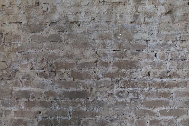 Mur z cegły, stara tekstura bloków kamiennych. tło.
