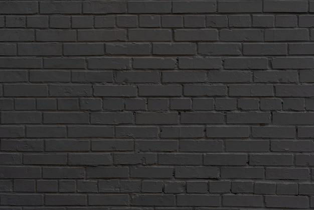 Mur z czarnej cegły. wnętrze nowoczesnego loftu. tło dla projektu