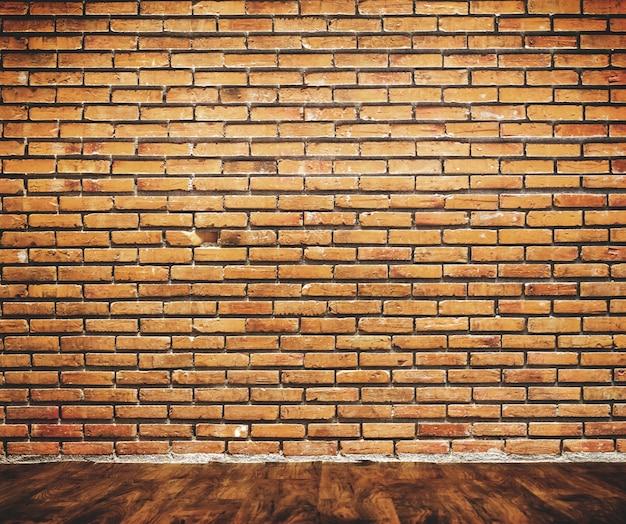 Mur z czerwonej cegły na tle