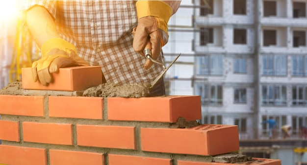 Murarz konstruktor architektura tło blok cegły murowanie