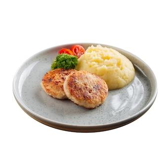 Na białym tle kotlet z kurczaka z puree ziemniaczanym