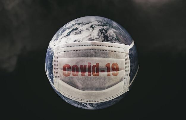 Na planecie ziemia medyczna maska chroniąca przed epidemią koronawirusa