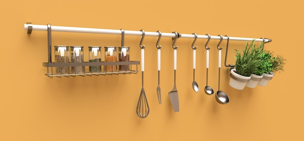 Na ścianie wiszą przybory kuchenne, sucha masa i przyprawy na żywo w doniczkach