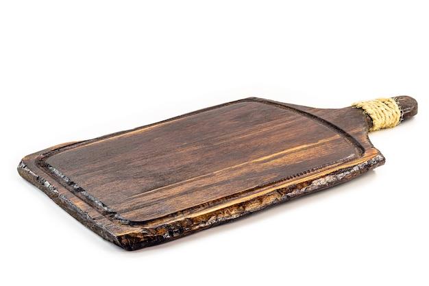 Naczynia kuchenne, vintage drewniana deska do krojenia, na białym tle