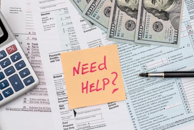 Naklejka 'potrzebujesz pomocy' z formularzem 1040 .