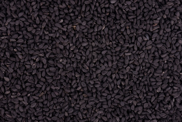 Nasiona kminku czarnego. nigella sativa. zbliżenie tła.