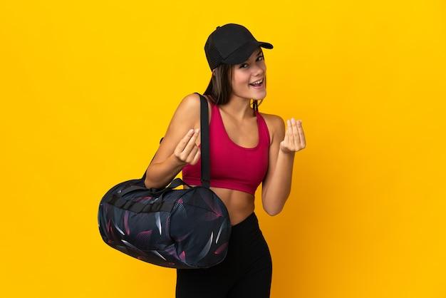 Nastolatek sport dziewczyna z sportową torbą robi pieniądze gestowi