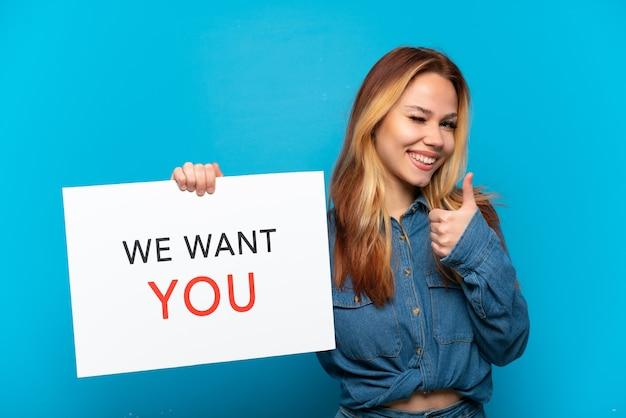 Nastoletnia dziewczyna trzyma deskę we want you i wskazuje na przód na odosobnionym niebieskim tle