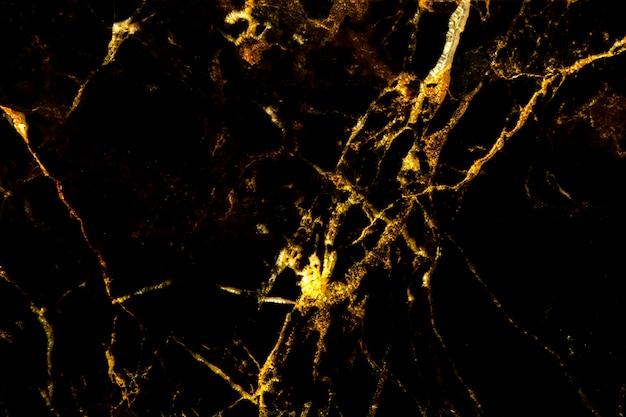 Naturalna faktura ze złotego marmuru dla ciemnej, abstrakcyjnej czerni marmurowej. złota koncepcja.