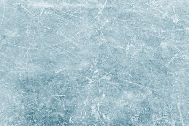 Naturalna tekstura lodu zimowego, niebieski lód jako tło