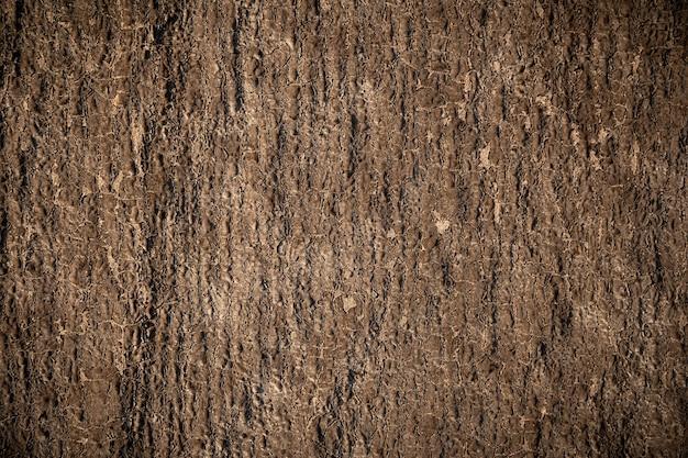 Naturalne brązowe tło postarzane przez zjawiska naturalne i czas. powłoka budowlana.