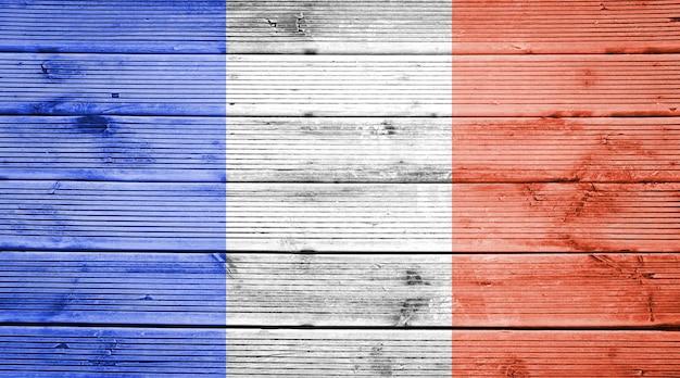 Naturalne drewniane deski tekstura tło z kolorami flagi francji