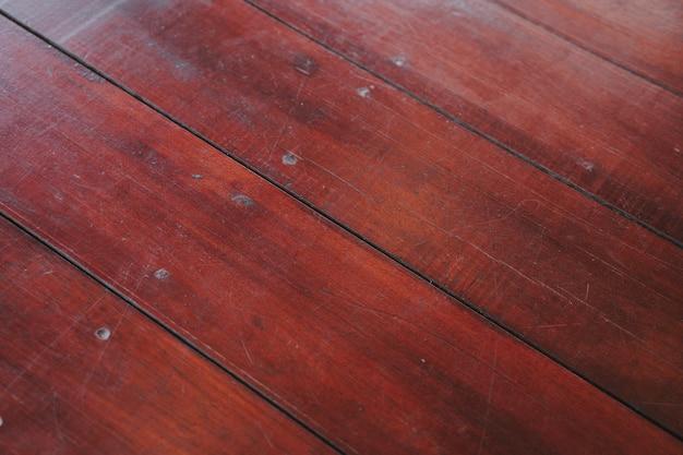 Naturalne jasnobrązowe drewniane deski podłogowe. pogodna miękka żółta tekstura, copyspace perspektywy tło.