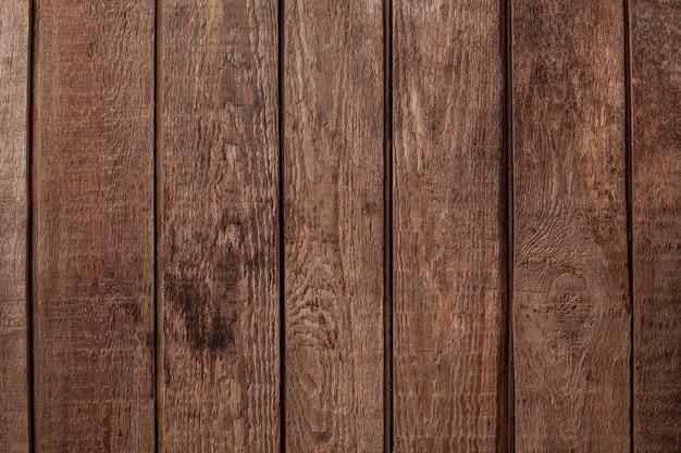 Naturalne tło tekstury postarzanych rustykalnych desek drewnianych