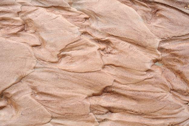 Naturalnego brązu piaska natury mokry mokry tło