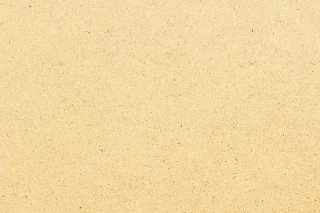 Naturalny brąz przetwarzający papierowy tekstury tło.