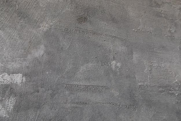 Naturalny czarny i szary tekstura ściany cement brudny kamień wzór tła o wysokiej rozdzielczości.