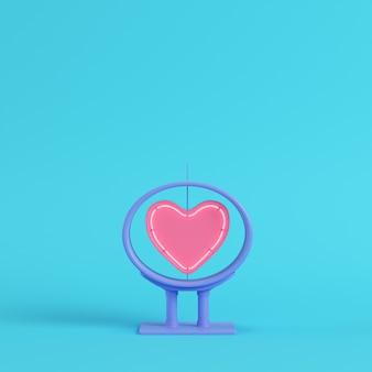 Neonowy kształt serca w ramce na jasnym niebieskim tle