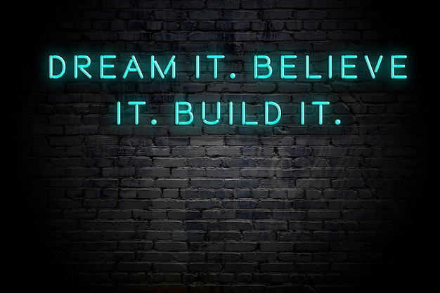 Neonowy napis pozytywnej mądrej motywacyjny cytat na ścianie z cegły