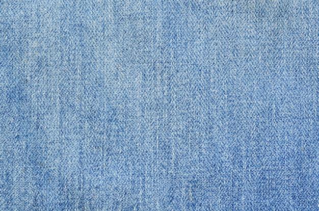 Niebiescy dżinsy tekstury drelichu tła wzór