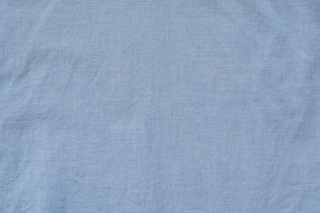 Niebieska bawełniana bezszwowa tkanina. tekstura tło