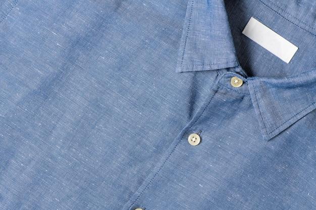 Niebieska bawełniana koszula lniana, koncepcja tkaniny tekstylnej