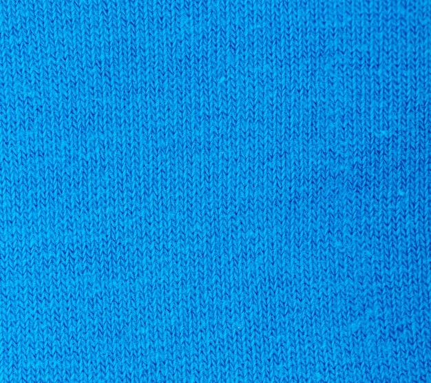 Niebieska dzianina tekstura streszczenie tło.