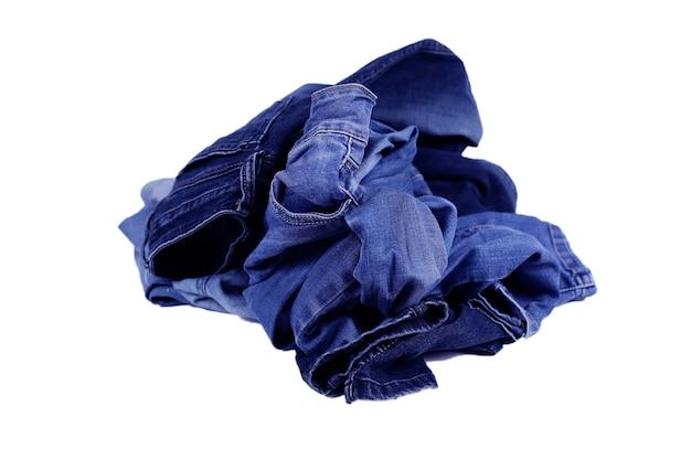 Niebieska dżinsowa tekstura, dżinsowa kompozycja spodni, stos