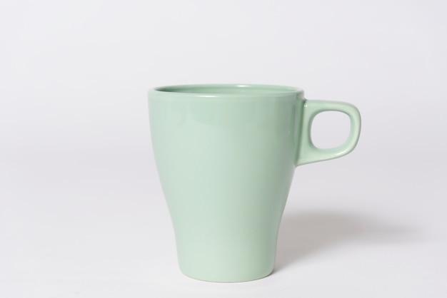 Niebieska filiżanka kawy. wykpić się z logo kreatywnego projektowania marki.