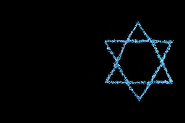 Niebieska gwiazda dawida. symbol żydowski na czarnym tle.