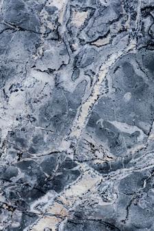 Niebieska marmurowa tekstura z smugami