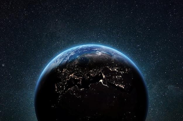 Niebieska planeta ziemia z panoramą i jasnymi światłami miasta w przestrzeni kosmicznej z gwiazdami.