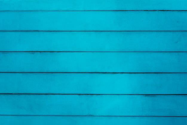 Niebieska powierzchnia stołu z drewna