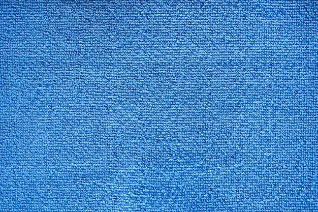Niebieska próbka tekstury ręcznika z mikrofibry frotte. tkanina tekstura tło. firma sprzątająca. makro