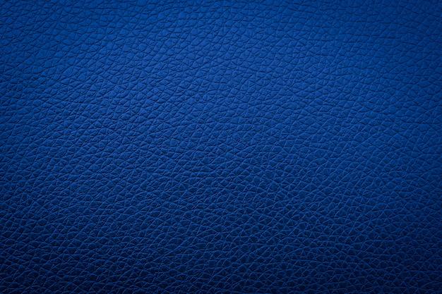 Niebieska skóra tekstury na tle, streszczenie sofa