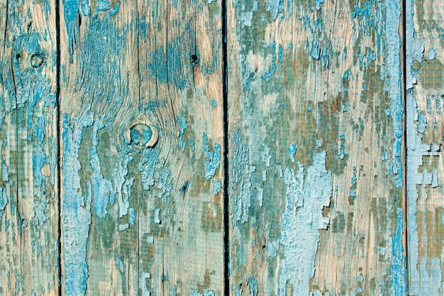 Niebieska tekstura starej farby na tle drewna