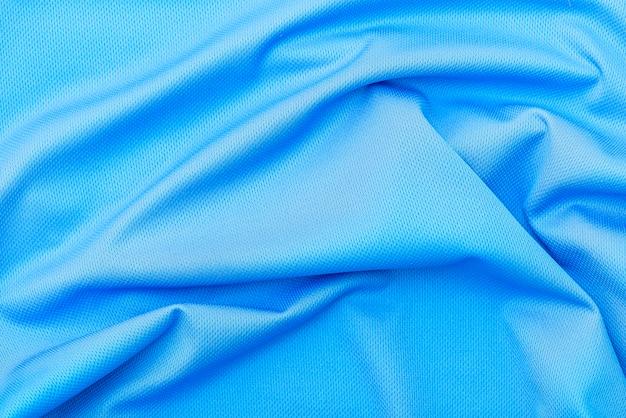 Niebieska tkanina tkaniny, tekstura poliestru, sport nosić tło