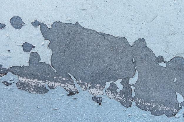 Niebieska wyblakła pomalowana ściana